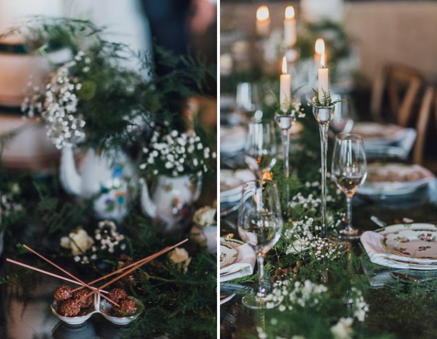 Ideen für eine Waldhochzeit mit viel Natur und Grün: Die Tischdeko mit Moos und einer Glasplatte über dem Holztisch