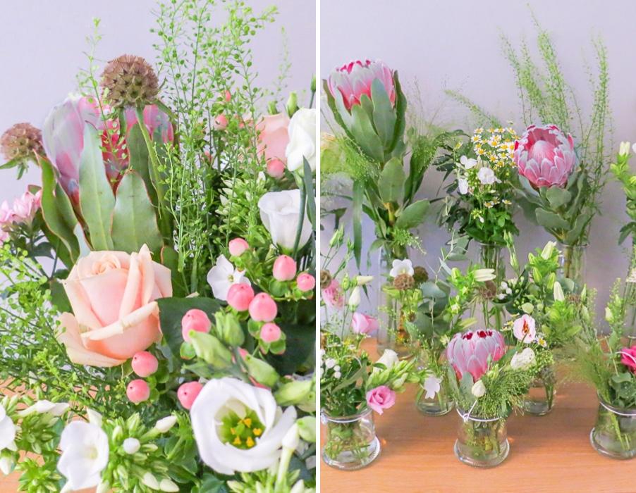 Hochzeit mit Protea. Blumen in einzelnen Vasen in Rosa und Weiß. Konzept von Hochzeitsgezwitscher